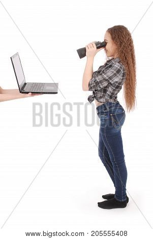 Happy teen school girl using binoculars looking at laptop screen isolated on white