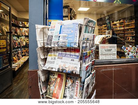 PARIS FRANCE - SEP 25 2017: International newspaper at press kiosk with portrait of Angela Merkel after election in Germany for the Chancellor of Germany the head of the federal government