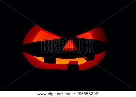 The Concept Of Halloween. The Ghastly, Ghastly Pumpkin Glows With A Fiery Yellow Light. Mystical Jac