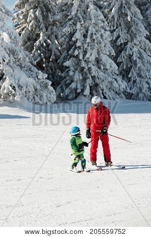Ski Trainer And Little Boy Skiing, Color Image, Two People