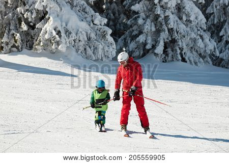 Little Boy And Ski Trainer, Color Image, Two People