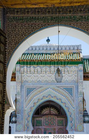 Elaborate and colorful mosque with many ornaments and carvings in Fes, Morocco, North Africa.