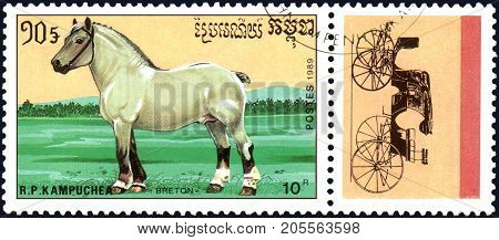 R.P. KAMPUCHEA - CIRCA 1989: A stamp printed in R.P. Kampuchea shows a Breton Horse, series breeds of horses
