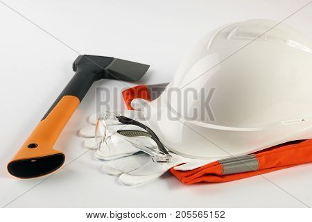 White Hard Hat With Working Tools Isolated On A White