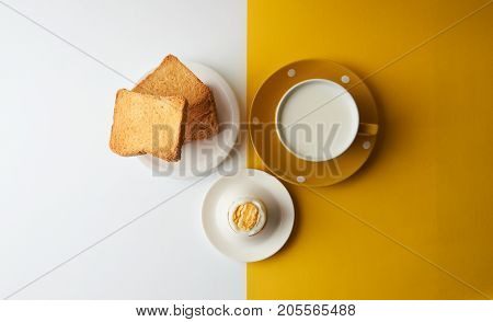 Flying Toasts For Breakfast And Cup Of Fresh Milk With Chicken Egg