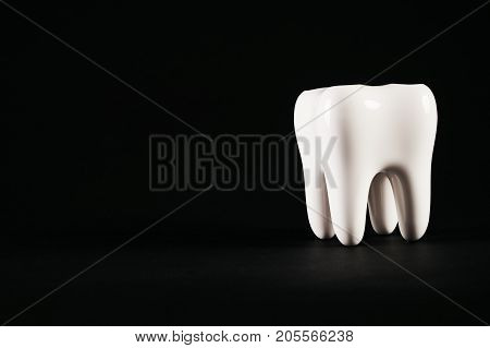 White Healthy Tooth Isolated On Black Background