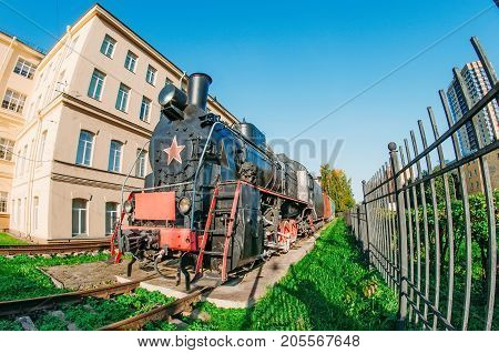 Retro Old Steam Locomotive At The Station Near The Platform