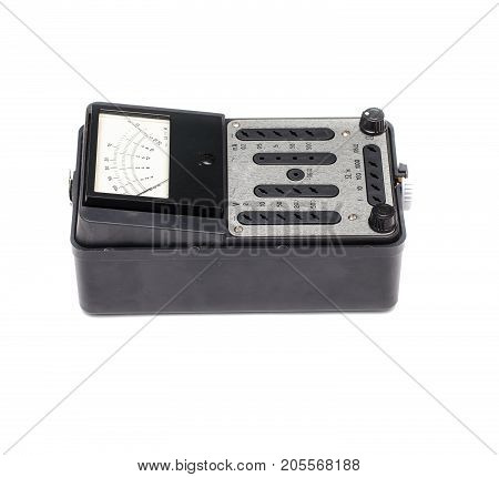Old retro multimeter isolated on white background. Obsolete technologies.