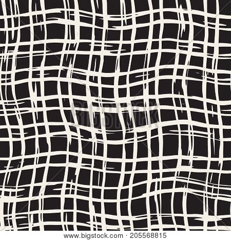 Hand drawn seamless plaid pattern. Allover pattern with ink doodle grunge grid. Graphic background with freehand line tartan.