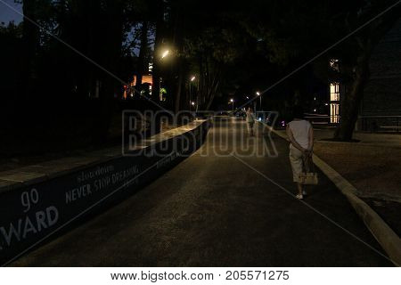 Yalta, Crimea - 11 July, People on the night lanes, 11 July, 2017. Night surroundings and adjoining territories of hotel Yalta Intourist.