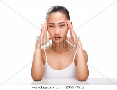 Young Asian Woman Having Headache Isolated On White Background