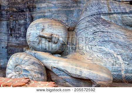 Statue of the reclining Buddha in parinirvana is the largest in Gal Vihara. Polonnaruwa, Sri Lanka