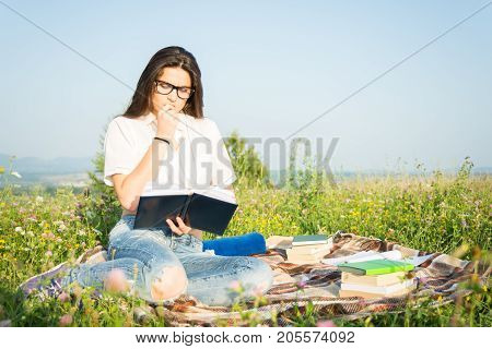 Gorgeous Woman With Book In The Spring Park.
