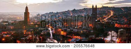 Aerial view of St. Anne's Church and Cathedral in Shandon, Cork, Ireland. Mountains and sunset cloudy sky