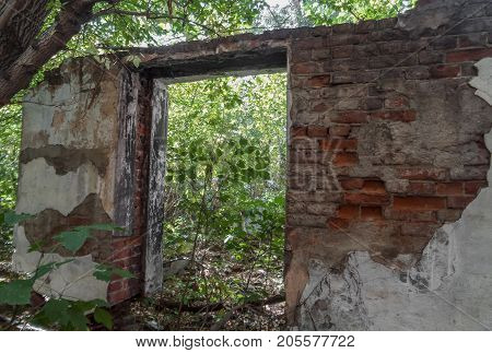 Fragment of the wall of the old destroyed building. Old architecture. Ust-Kamenogorsk. Ruined building