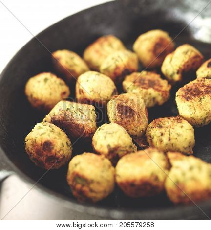 Fried falafel in a cast-iron pan close up. Middle eastern dish falafel pan