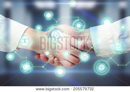 Side view and close up of handshake with abstract digital business network hologram. Teamwork and future concept. Double exposure