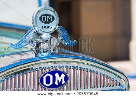 San Pellegrino Terme, Italy - July 16, 2017: Vintage Classic Car Show - Closeup On Om Icon Of An Old