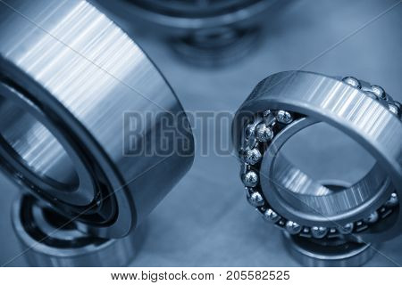 The metal ball bearing spare part on the violet carpet.The hi-precision mechanical part.
