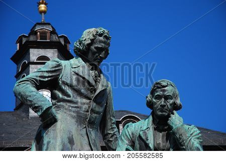 Statue of the Grimm Brothers, looking down, City of Hanau - Germany; horizontal format
