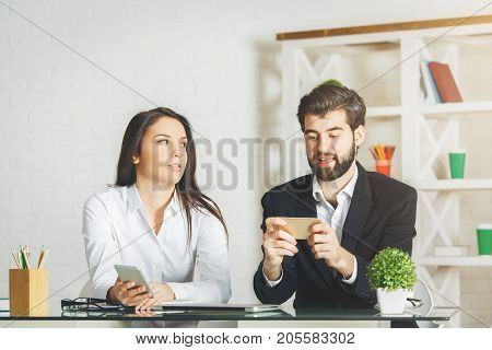 White Businessman And Woman Using Smartphone