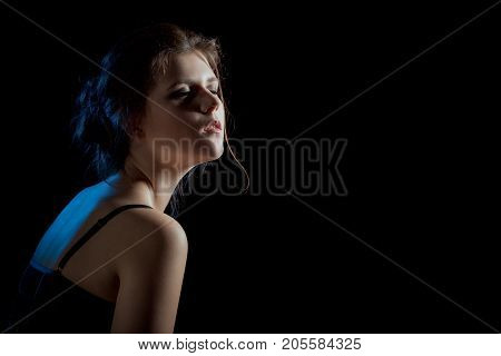 sensual dreaming woman in enjoyment on black background with copy space