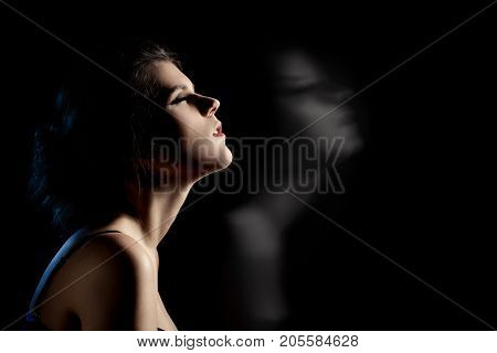 sensual dreaming woman in enjoyment at dark
