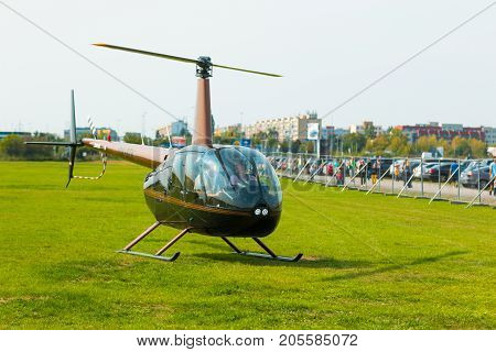 PRAGUE, CZECH REPUBLIC - 9.09.2017: New civil black helicopter use like business transportation, People in helicopter in Prague, Czech Republic