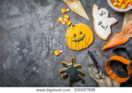 Halloween concept - baking background with cookies and candies, cutters, rustic background