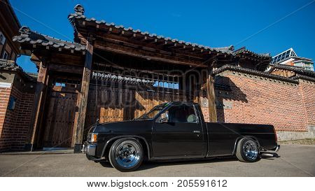 Khabarovsk, Russia - August 28, 2016 : car Nissan Datsun pickup truck on the street, around the house in Japanese style