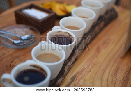 Eight kinds of coffee on a wooden tray, including Kopi Luwak, the traditional balinese coffee