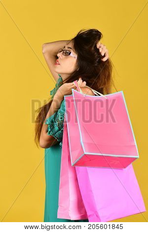 Woman Wears Fashionable Dress Touching Hair. Shopping And Spending Concept.