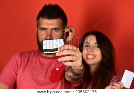 Man With Beard Holds Credit Card, Close Up.