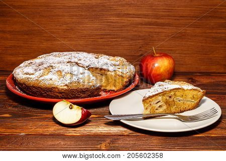 Freshly Baked Apple Pie On A Rustic Background Of Dark Wood. Fresh Apples And A Piece Of Apple Pie S