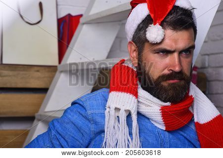 Holidays And Presents Concept. Guy With Beard And Concerned Face