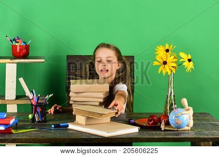 Girl With Enthusiastic Face Takes Book. Back To School