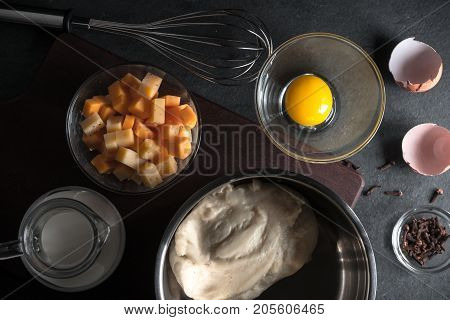 Cooking mornay sauce, cheese and eggs horizontal