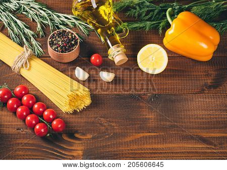 Spaghetti, Tomatoes Cherry, Olive Oil, Herb And Spices On Old Brown Wooden Background.