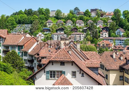 Bern Switzerland - May 26 2016: Architecture of the old European town and medieval tiled roof in Bern (Unesco Heritage) the capital of Switzerland.