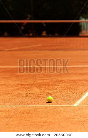 Clay Tennis Court With Ball