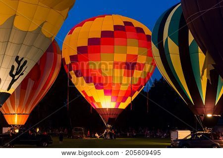 Seymour WI - August 12 2017: Hot air balloon glow during Hamburger Fest in Seymour WI. Hot air balloons are an integral part of the annual festival which celebrates Seymour as the birthplace of the hamburger.
