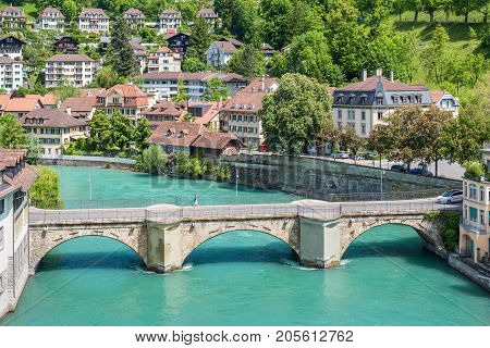 Bern Switzerland - May 26 2016: Architecture of the old European town coastal cityscape with river and bridge in Bern (Unesco Heritage) the capital of Switzerland.