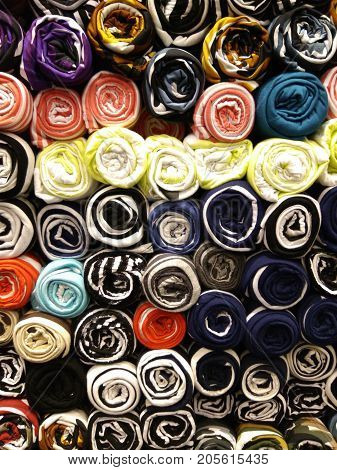 Pants or underwear are stacked rolls. Colorful underwear.