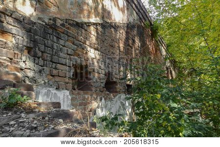 Fragment of the wall of a very old building. Old architecture. Abandoned building. Old city. Historical heritage. Historical architecture