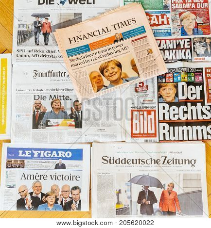 PARIS FRANCE - SEP 25 2017: International newspaper with Financial Times portrait of Angela Merkel after election in Germany for the Chancellor of Germany the head of the federal government