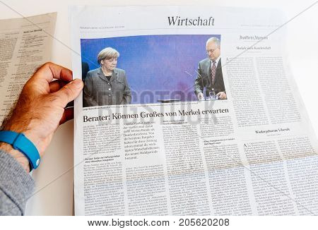 PARIS FRANCE - SEP 25 2017: International newspaper frankfurter allgemeine zeitung with portrait of Angela Merkel and Martin Schulz after election in Germany for the Chancellor of Germany the head of the federal government