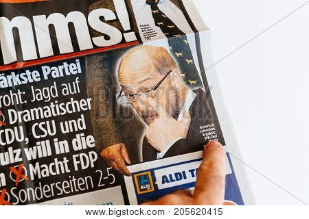 PARIS FRANCE - SEP 25 2017: Man pointing to crying Martin Schulz photo onthe Bild german newspaper after election in Germany for the Chancellor of Germany the head of the federal government