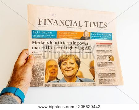 PARIS FRANCE - SEP 25 2017: Financial Times with portrait of Angela Merkel after election in Germany for the Chancellor of Germany the head of the federal government