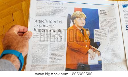 PARIS FRANCE - SEP 25 2017: Le Figaro French International newspaper with portrait of Angela Merkel after election in Germany for the Chancellor of Germany the head of the federal government