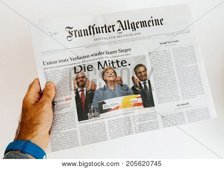 PARIS FRANCE - SEP 25 2017: International newspaper with portrait of Angela Merkel after election in Germany for the Chancellor of Germany the head of the federal government